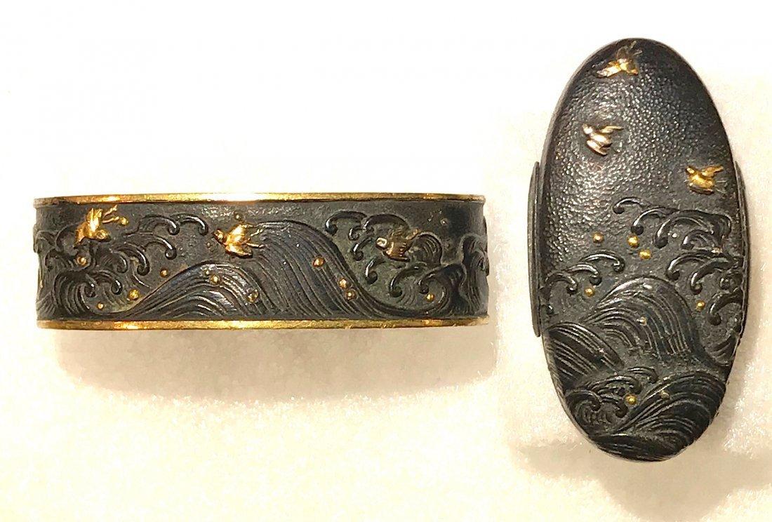Fuchi-Kashira of shakudo with gold inlay