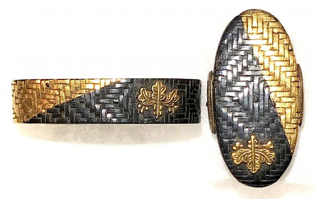 Fuchi-Kashira of gold and shakudo with a kiri-mon