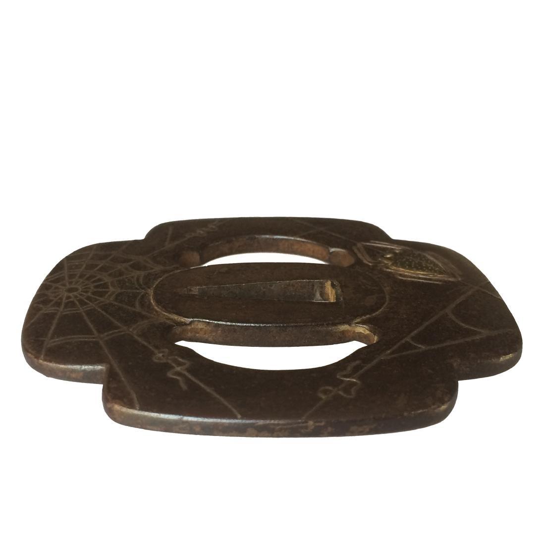 A Higo school iron tsuba with silver and brass inlay - 2