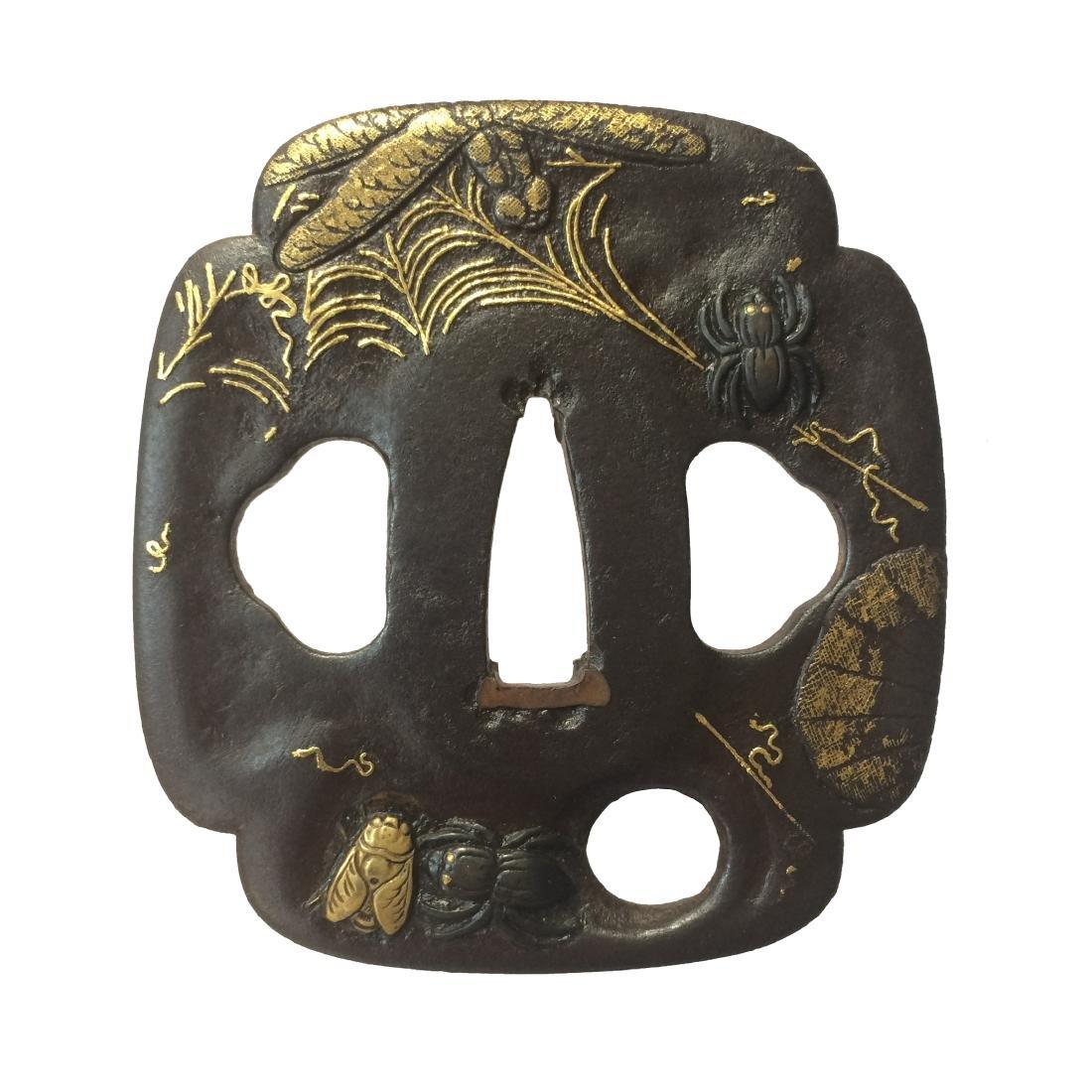 Kumagai (Edo-Higo) tsuba of iron with shakudo and gold