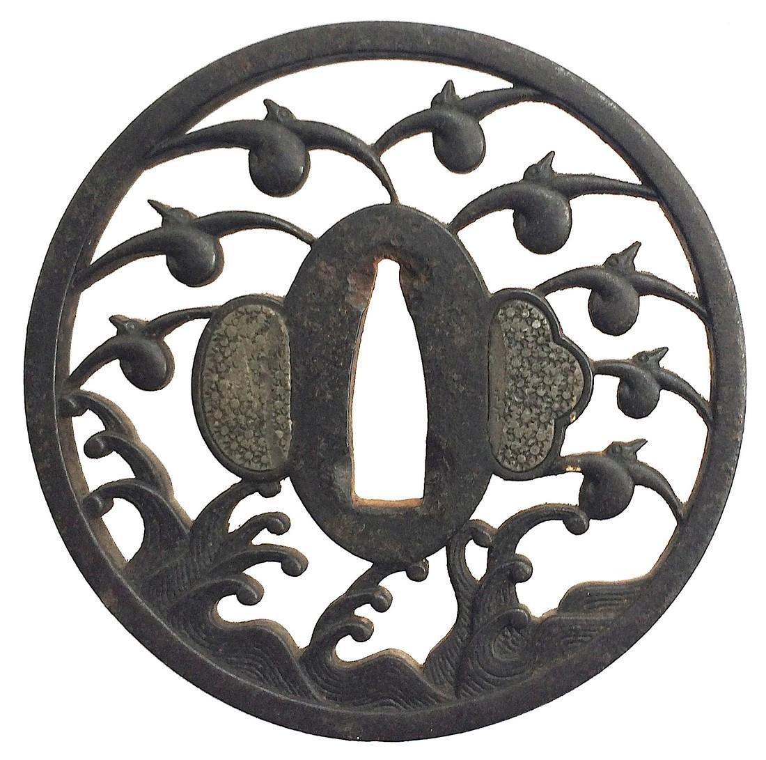 Signed iron sukashi tsuba by Myochin Katsuharu of