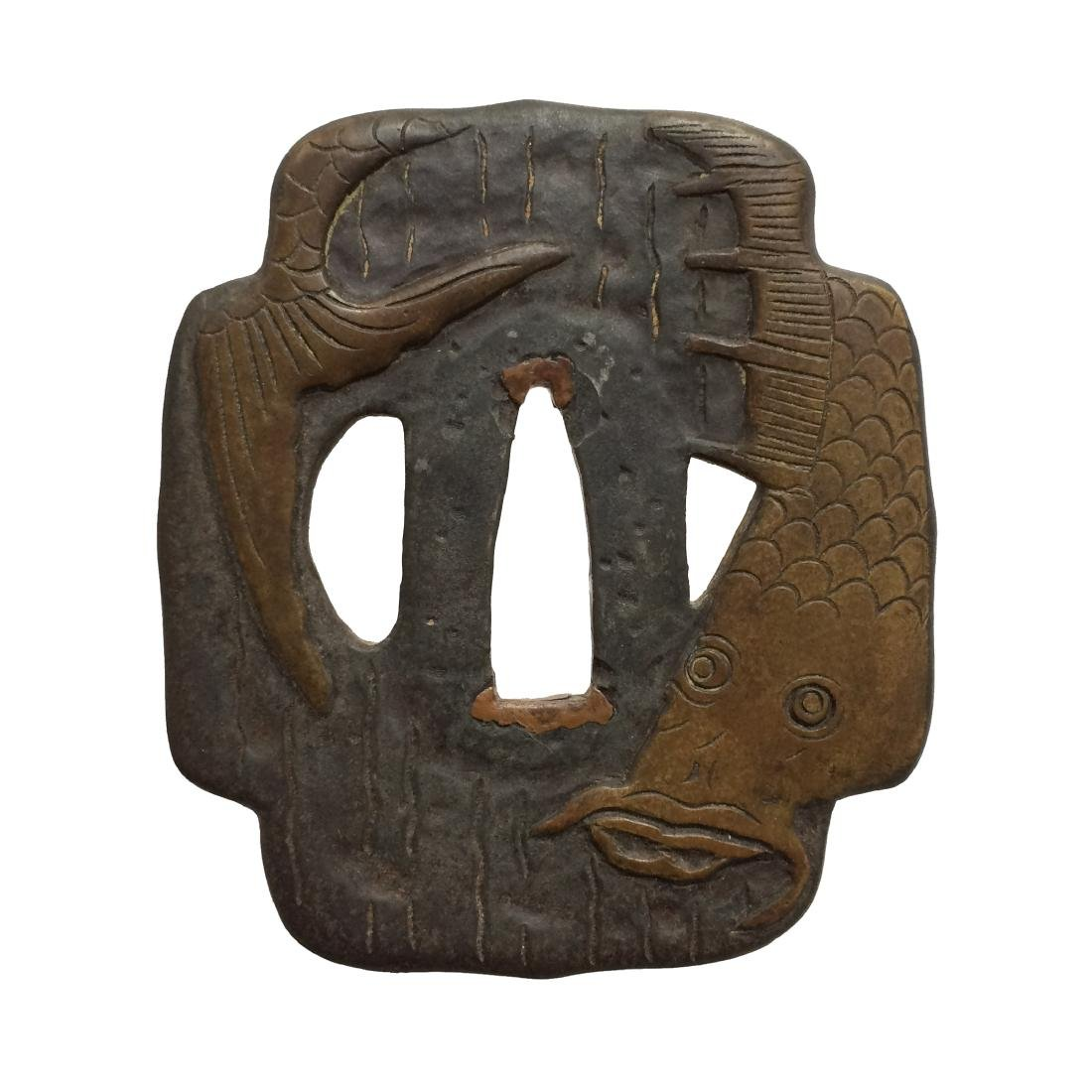 Iron tsuba carved and inlaid with brass