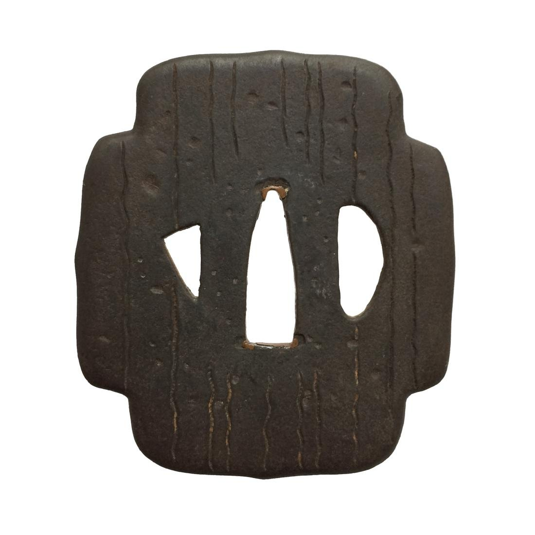 Iron tsuba carved and inlaid with brass - 2