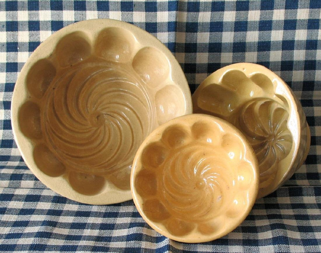 Group of Three Vintage Yelloware Swirl Molds - 3