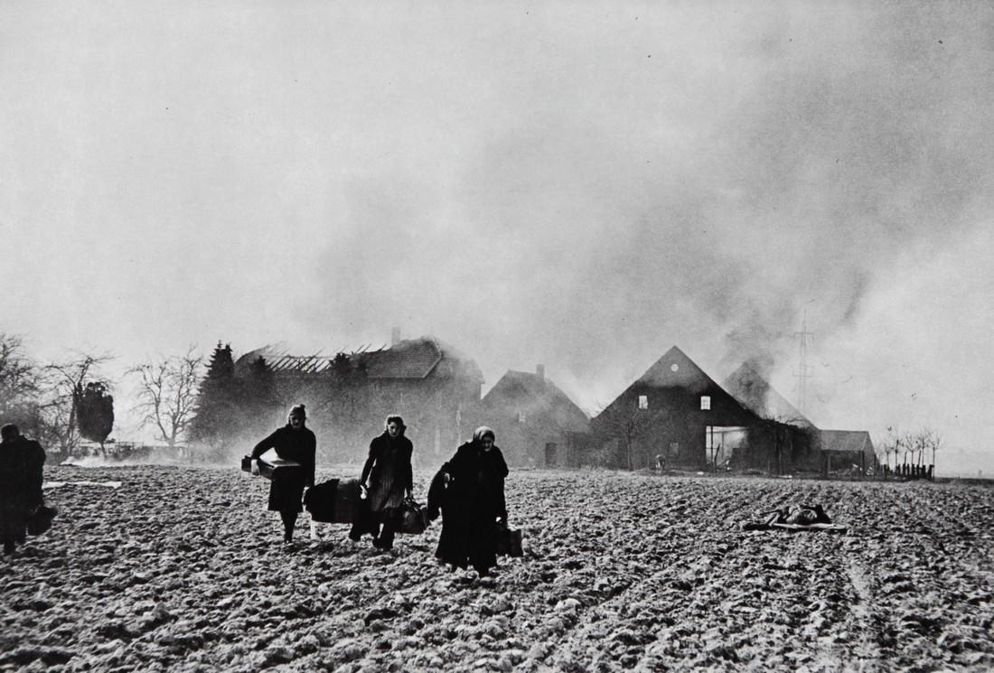 ROBERT CAPA - German civilian blasted farm house