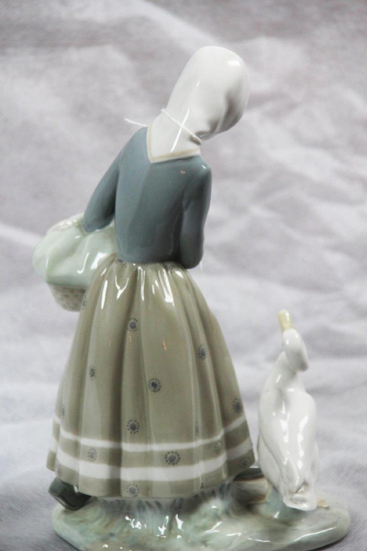 "LLadro #4568 ""Shepherdess With Geese."" Glazed. - 4"