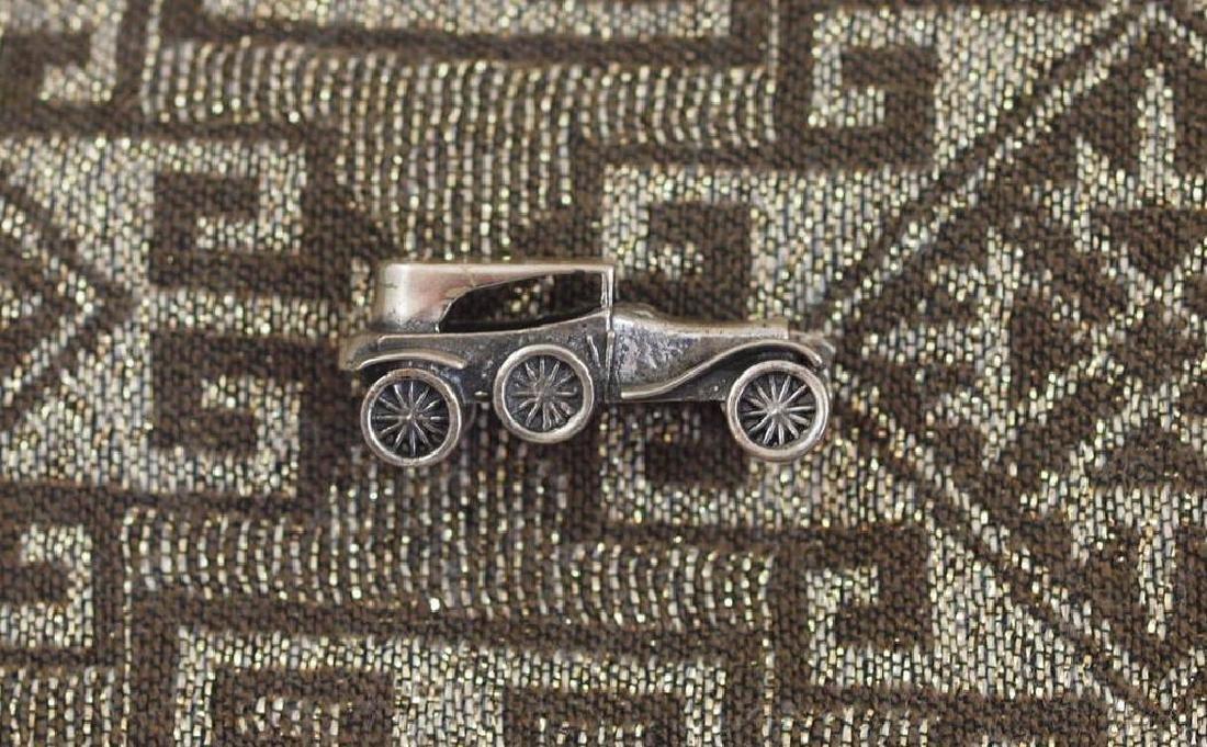Vintage Enchanting model in silver 800 of vintage car