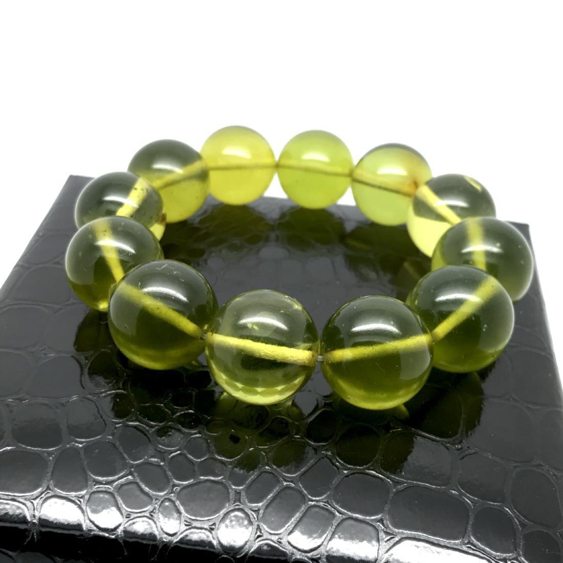 Cut young amber beads bracelet 24.6 gr - 2