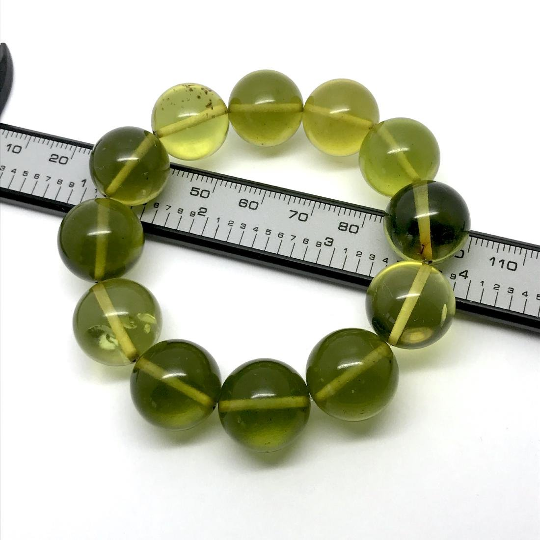 Cut young amber beads bracelet 24.6 gr - 5
