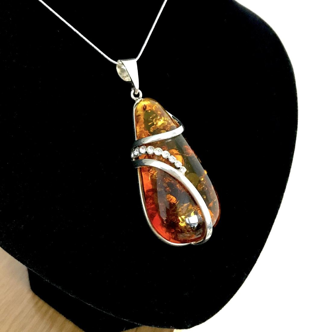 Vintage sterling silver drop pendant with Baltic amber