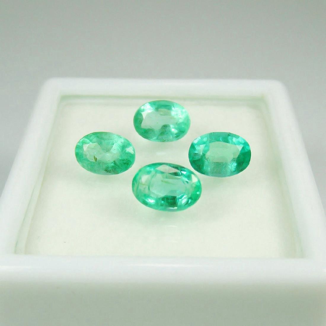 2.01 Carat 4 Loose Octagon Emeralds Oval Set