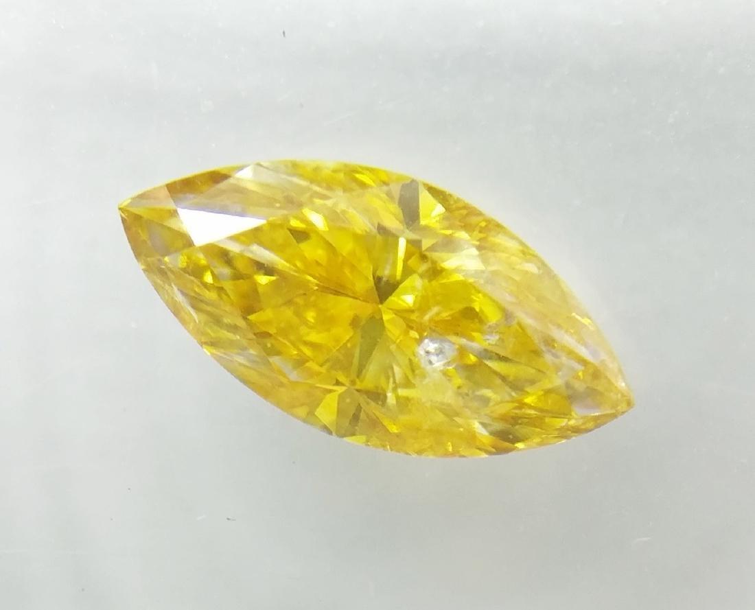 0.72 ct Marquise cut diamond Fancy Vivid Orangy Yellow
