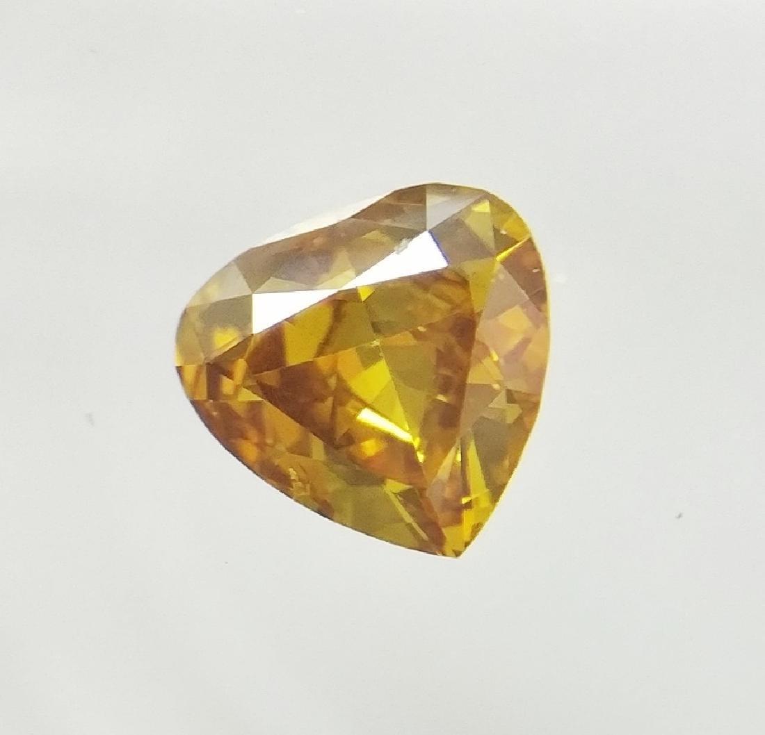 0.24 ct Heart cut diamond F.V.Br.Orangy Yellow VS2