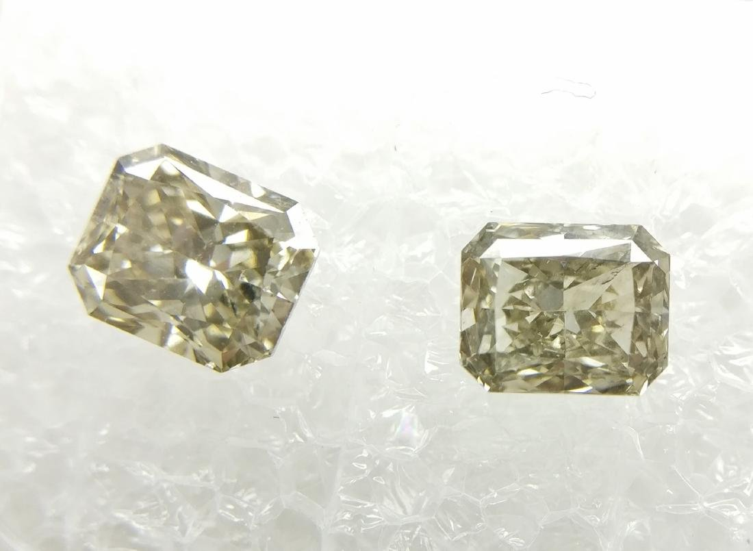 Couple of 2 Radiant cut diamonds total 1.18 ct