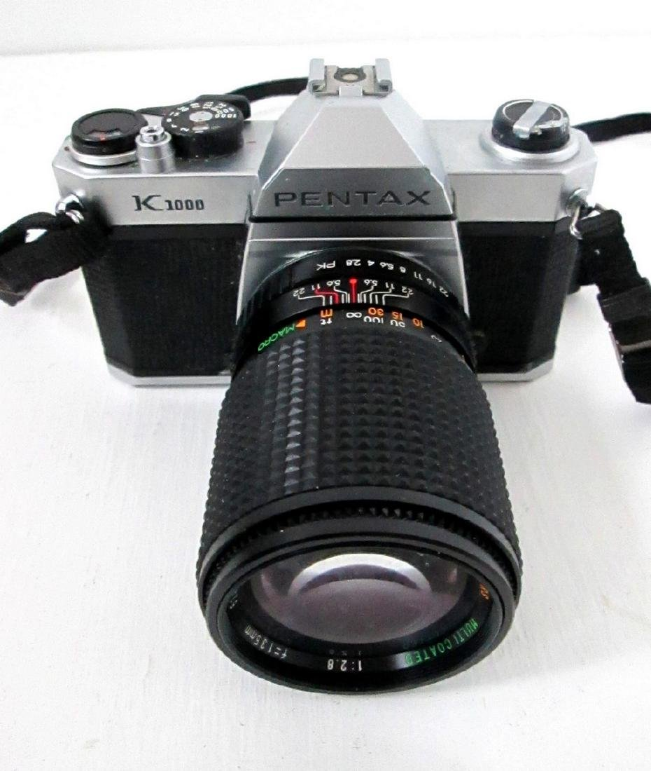 Pentax SLR Camera With Telephoto Lens