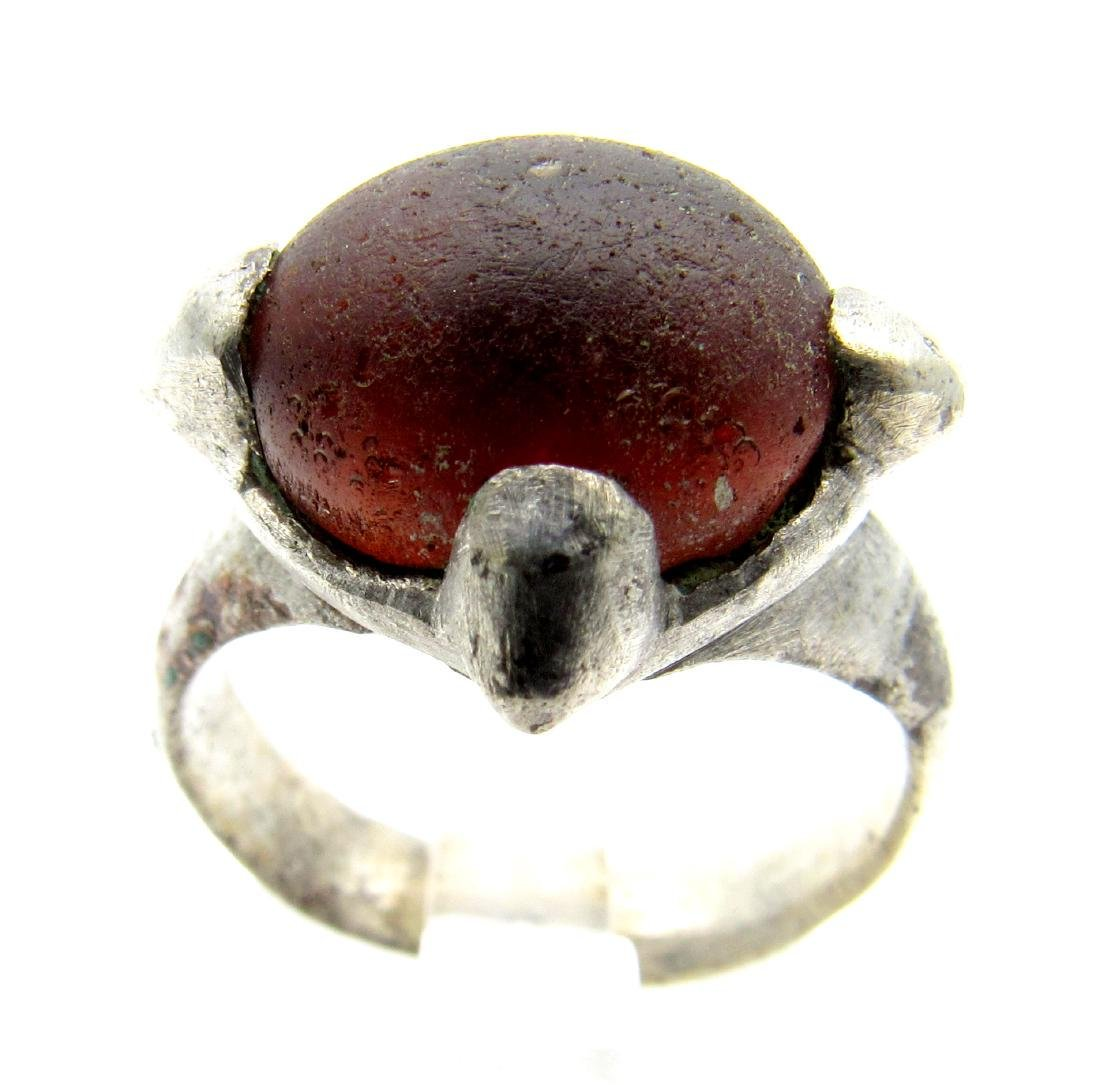 Medieval Viking ring with a dark stone in the bezel