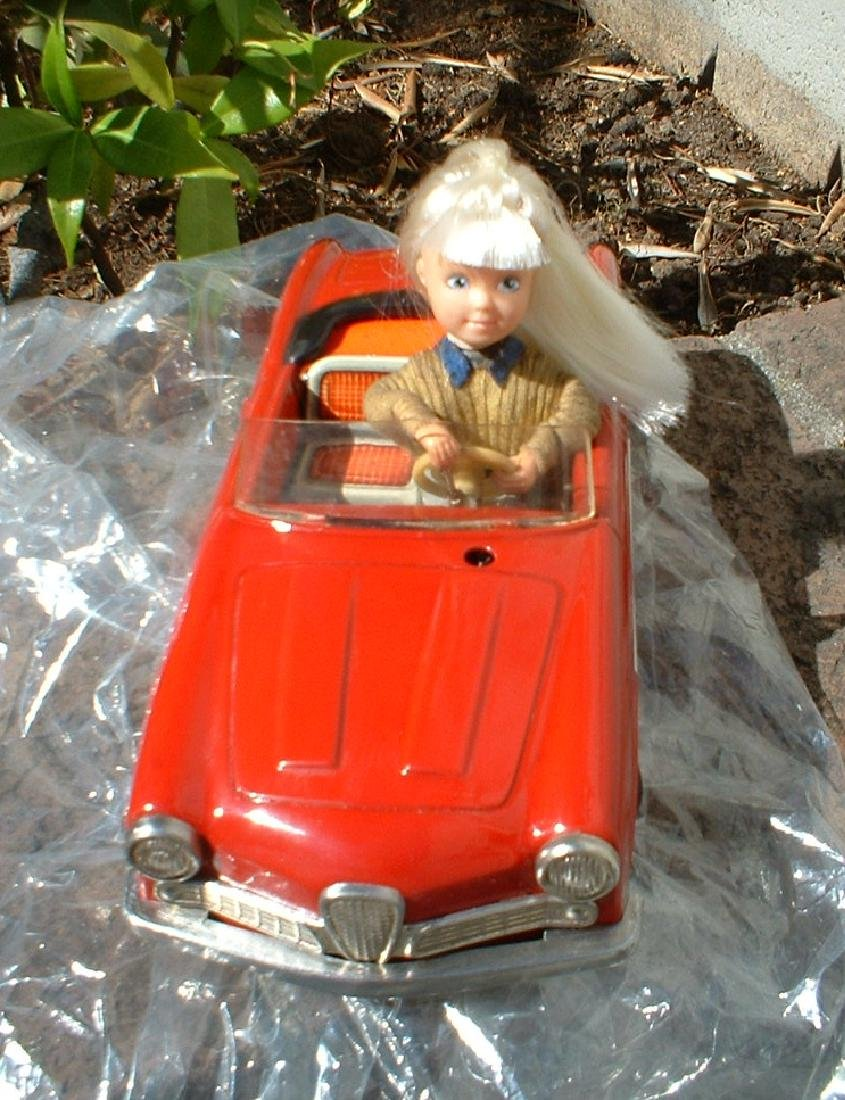 "Schuco ""Texi"" animated doll drives the Italian Alfa"