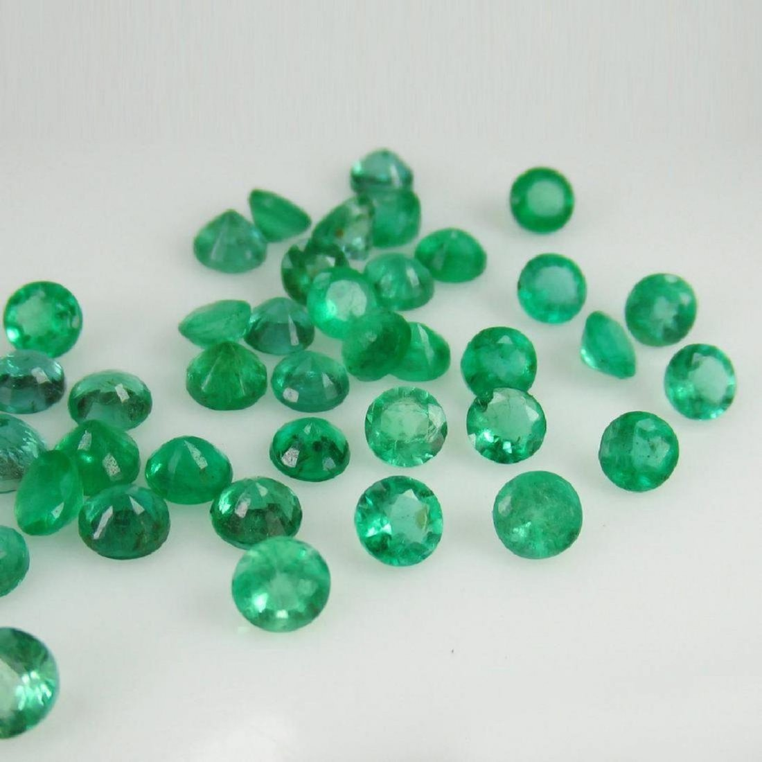 "10.10 Carat 47 Loose Round ""Diamond cut"" Emeralds"