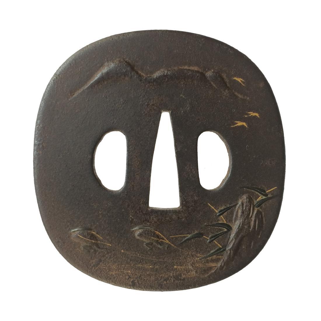 Iron tsuba with gold inlay