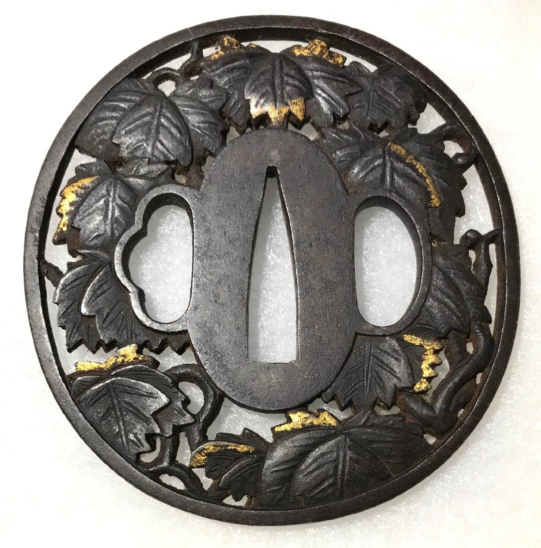 Iron tsuba carved and inlaid with gold - 2