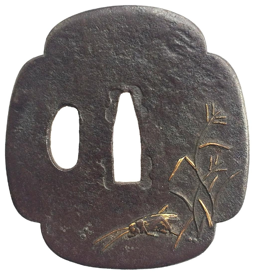 Iron tsuba with shakud? and gold inlay; with provenance