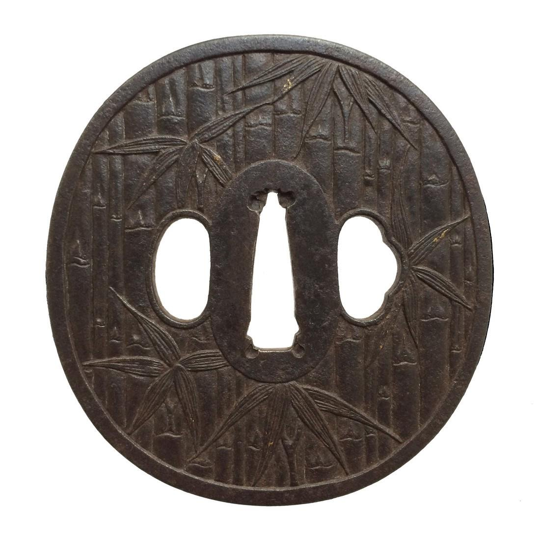 Iron tsuba carved with a bamboo motif