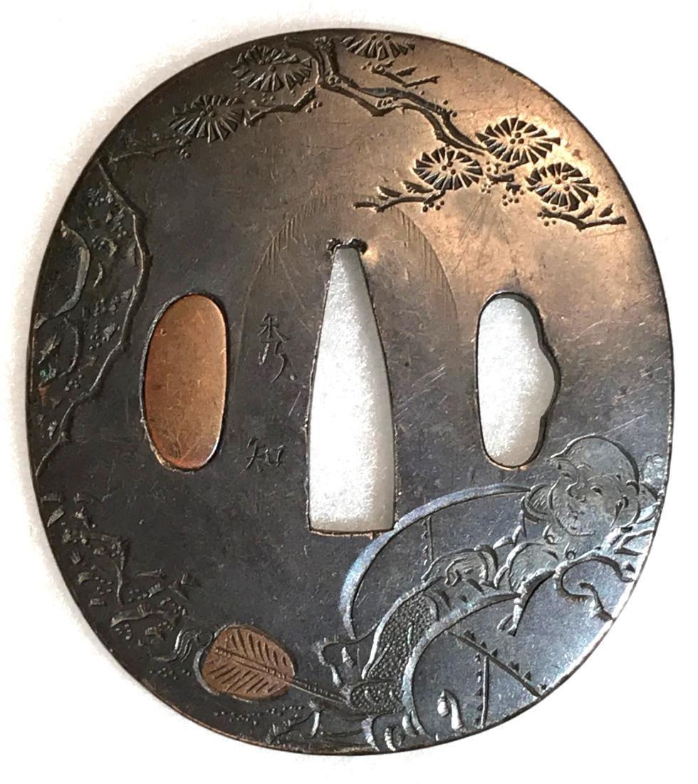 Signed kinko tsuba with katakiribori carving and brass