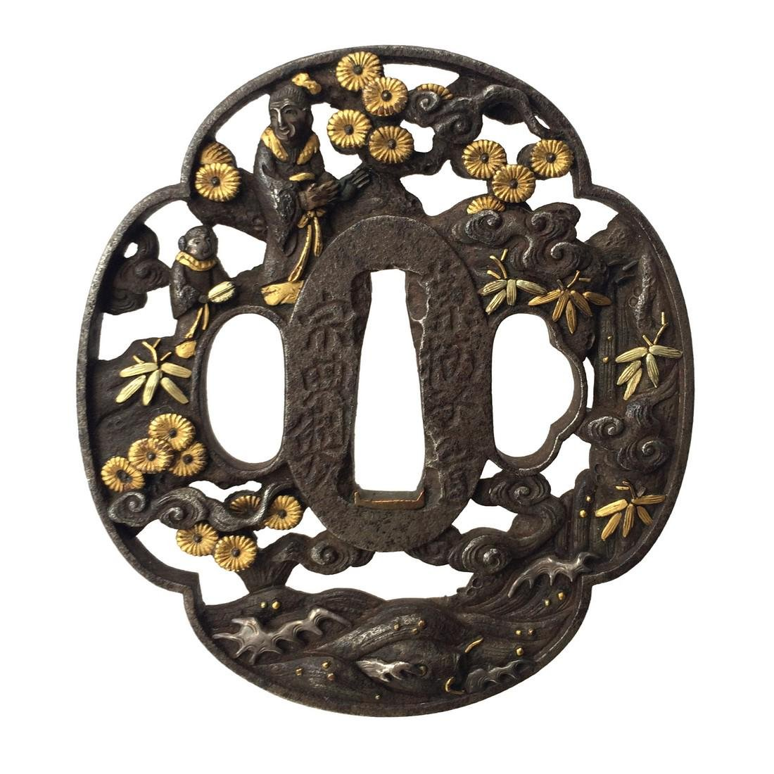 Signed Iron tsuba carved in marubori and inlaid with