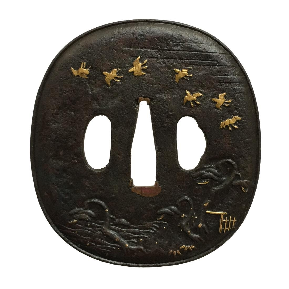 Iron tsuba by Aizu Shoami school, carved and inlaid