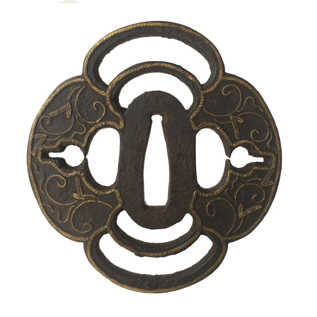 Heianjo school iron tsuba with brass inlay