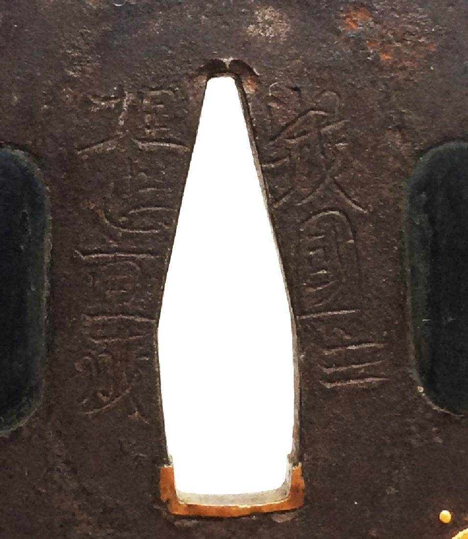 Signed iron tsuba carved and inlaid with gold byUmetada