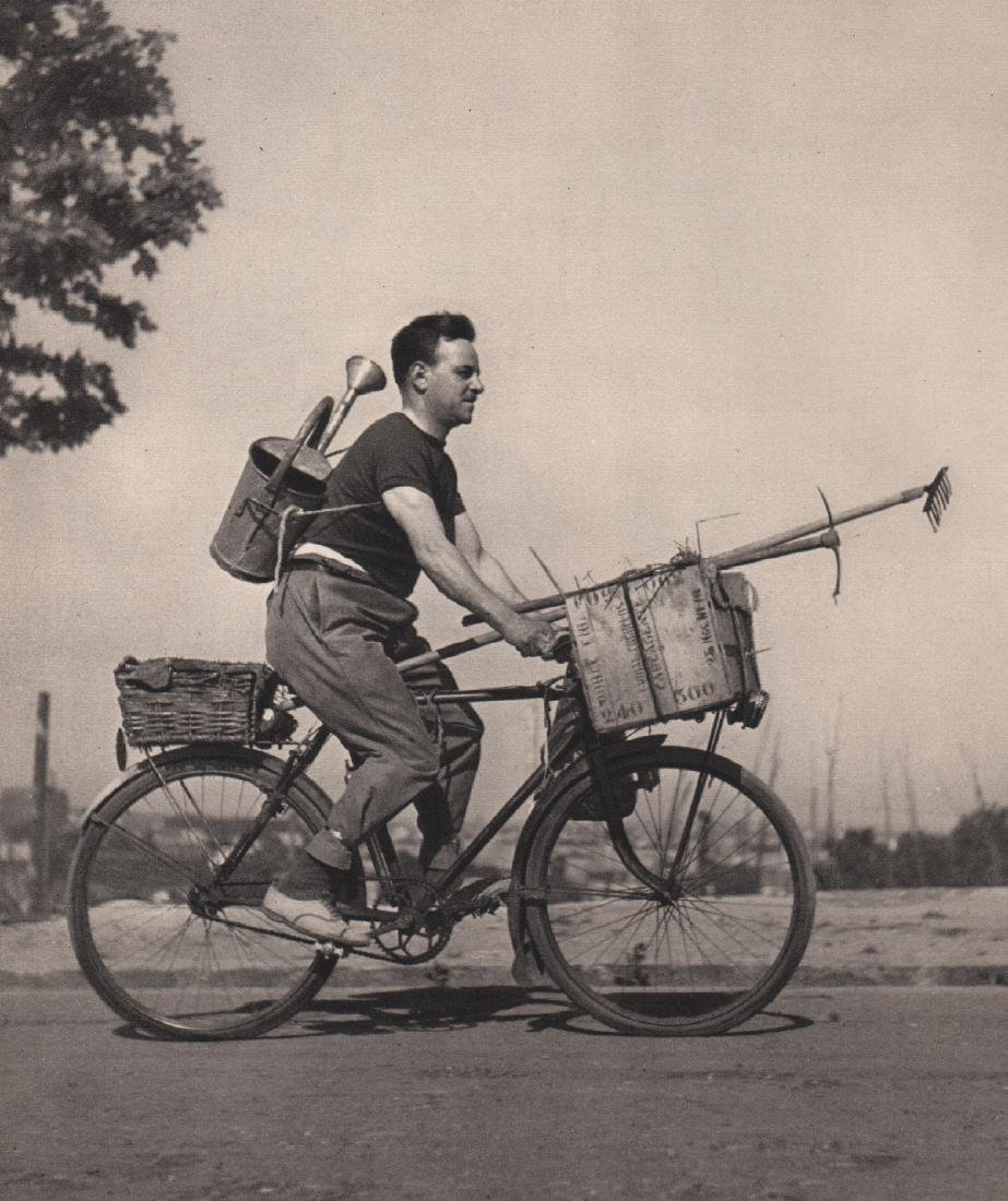 ROBERT DOISNEAU - Sun King on a Bicycle