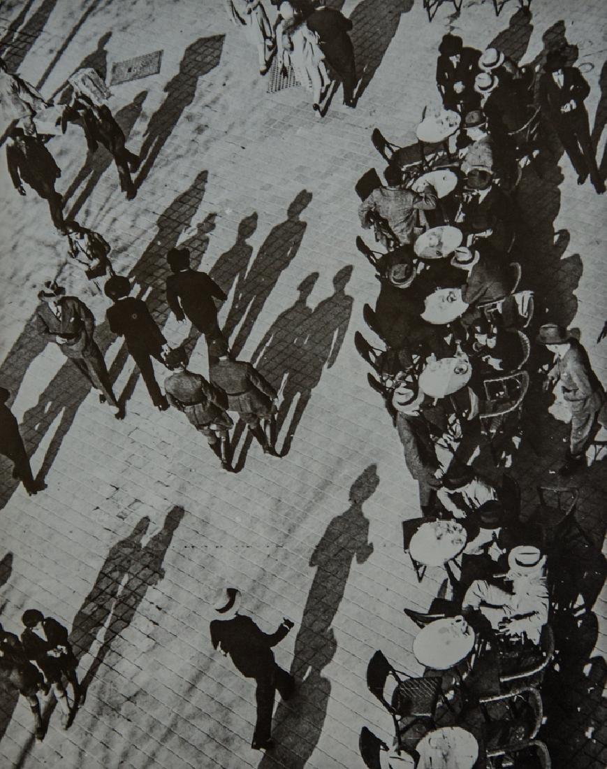 MARTIN MUNKACSI - Shadow Figures Across Square