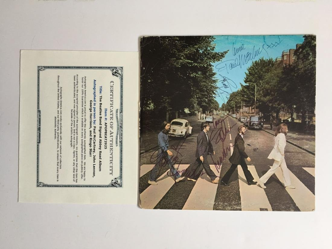 THE BEATLES MULTIPLE SIGNED ALBUM WITH COA