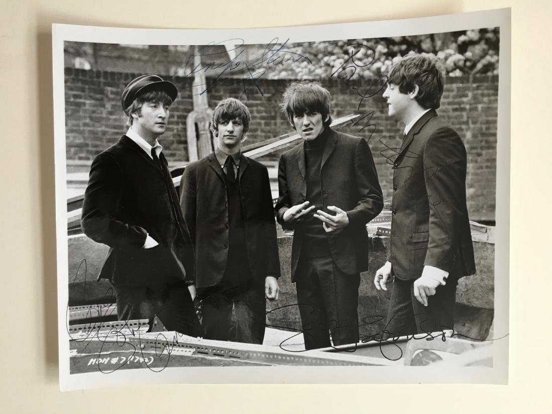 THE BEATLES SIGNED PRESS PHOTO