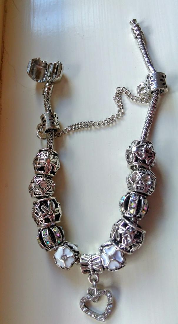 Silvertone Heart Charm Bracelet With Swarovski