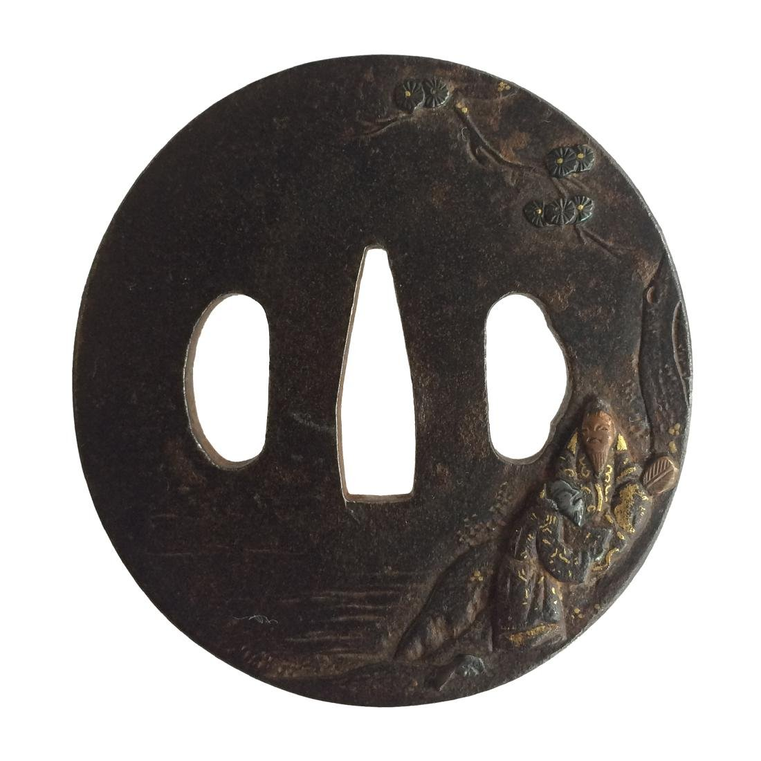 Iron tsuba with inlay and carving