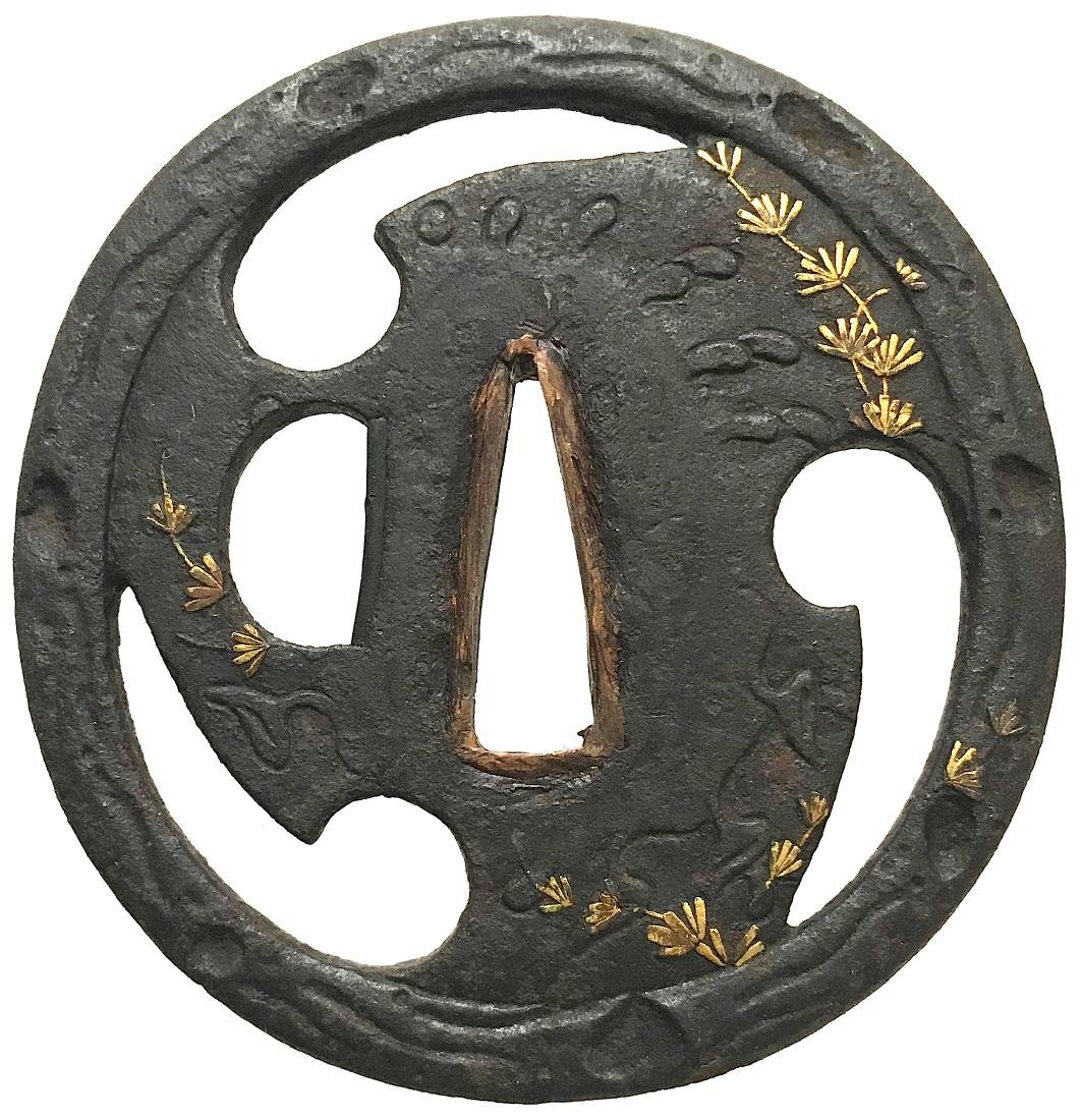 Sukashi tsuba with gold inlay and tomoe motif
