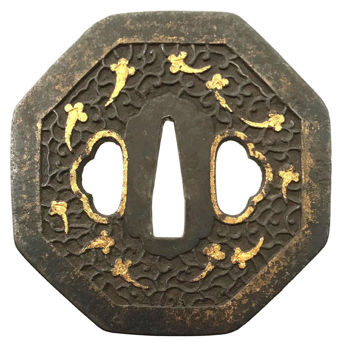 Iron tsuba with myriad treasures motif