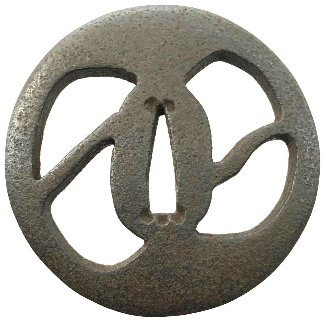 Sukashi tsuba of iron