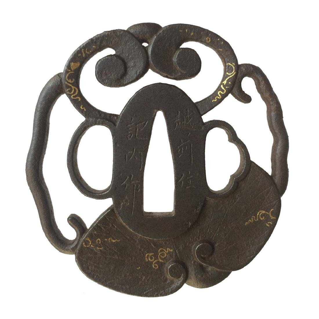 Iron tsuba with aoi leaves and tendrils motif, signed