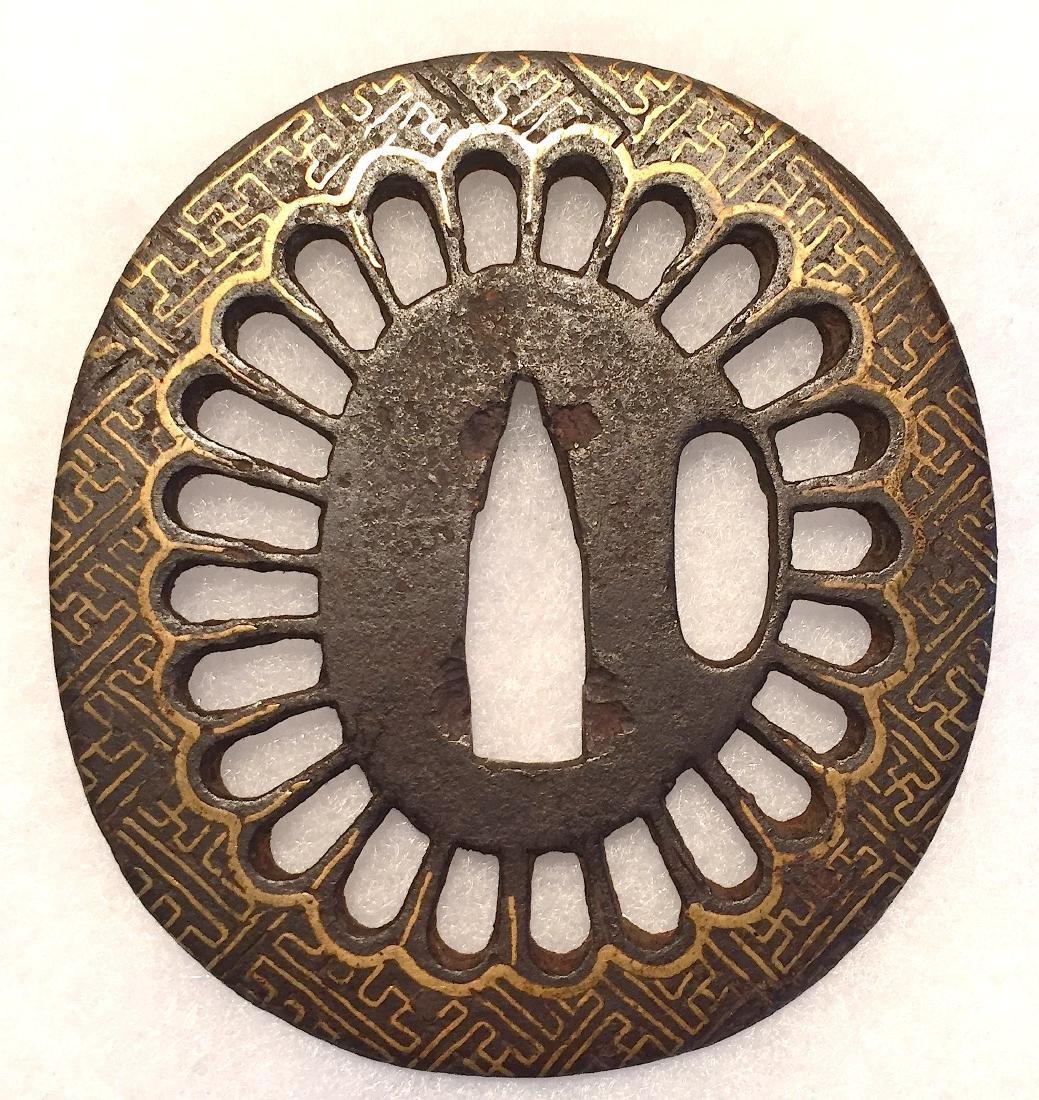 Iron tsuba inlaid with gold. Chrysanthemum motif. - 2
