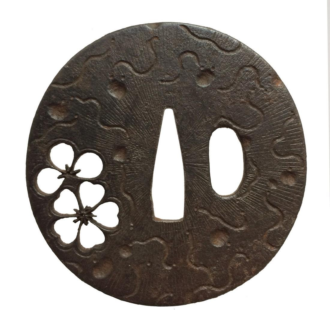 Iron sukashi tsuba with plum and cherry blossoms motif
