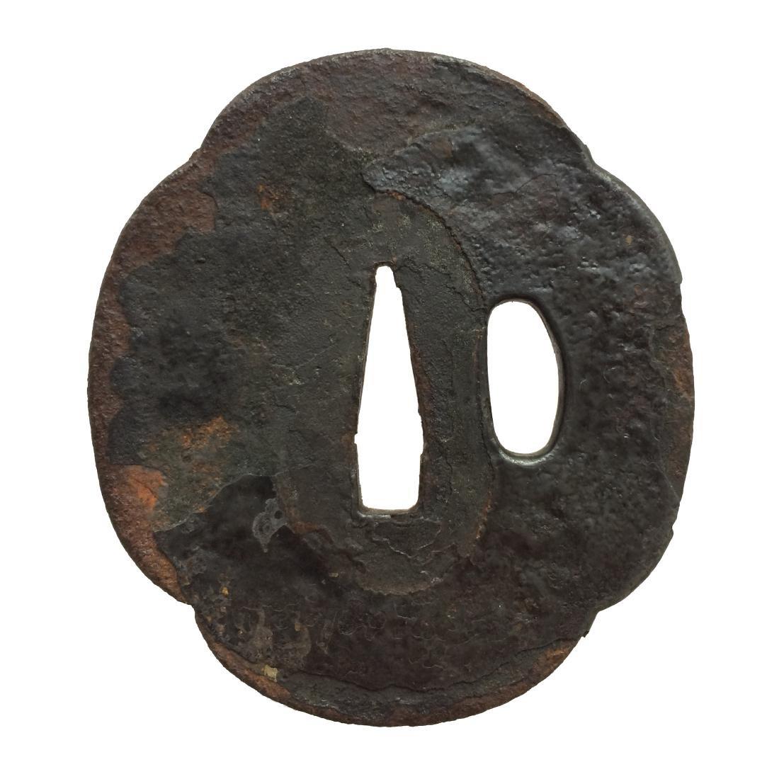 Iron tsuba with a broken umbrella motif - 2
