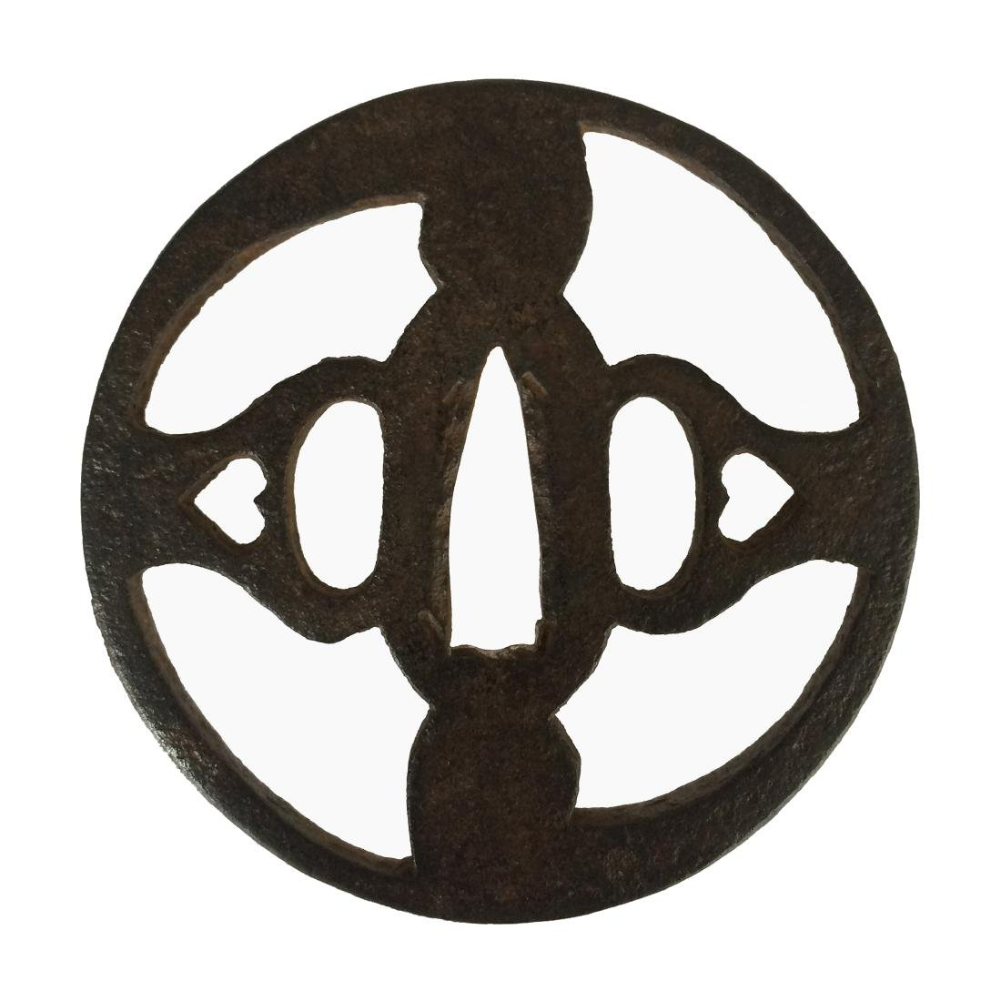 Iron sukashi tsuba with tomoe motif