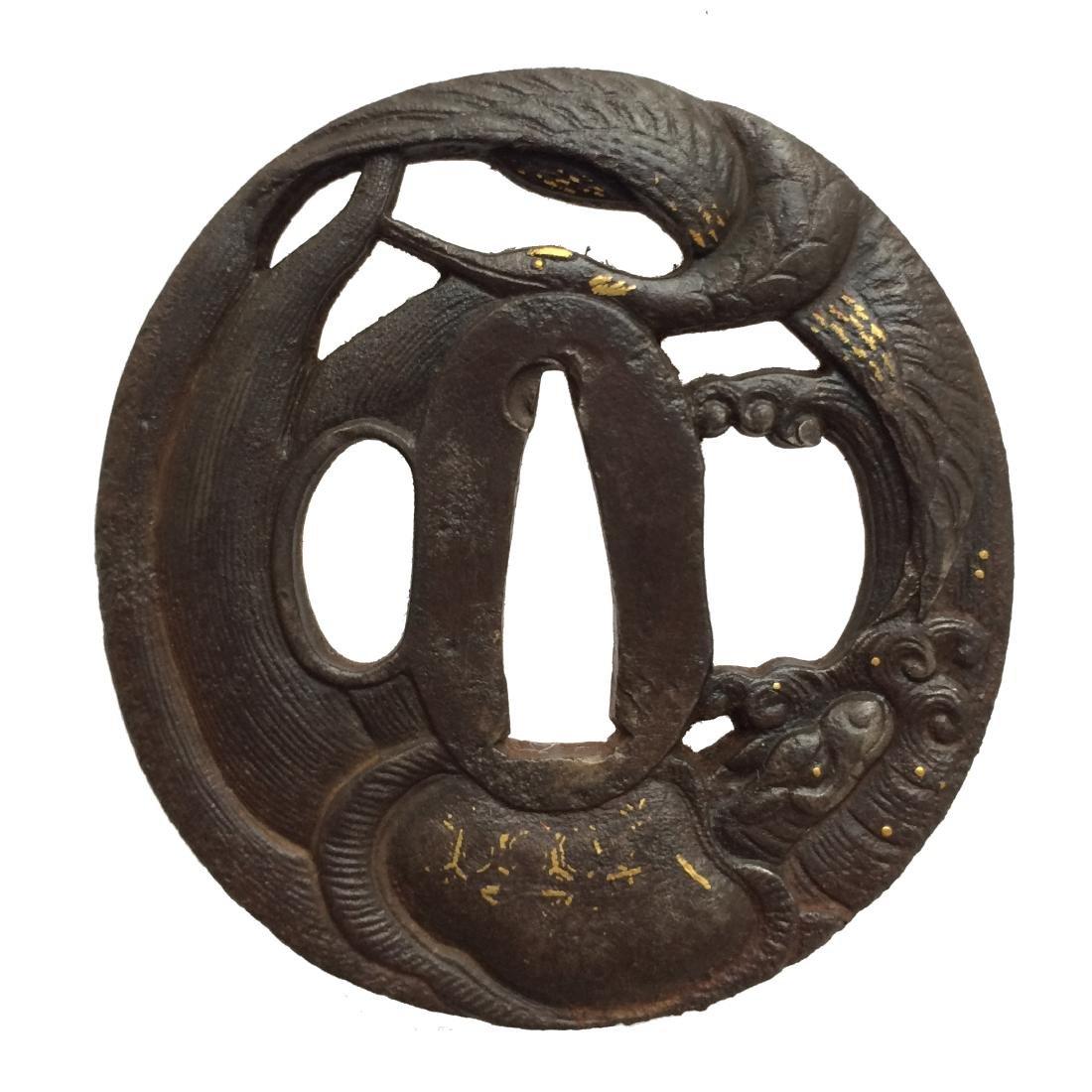 Iron tsuba with tortoise and crane motif