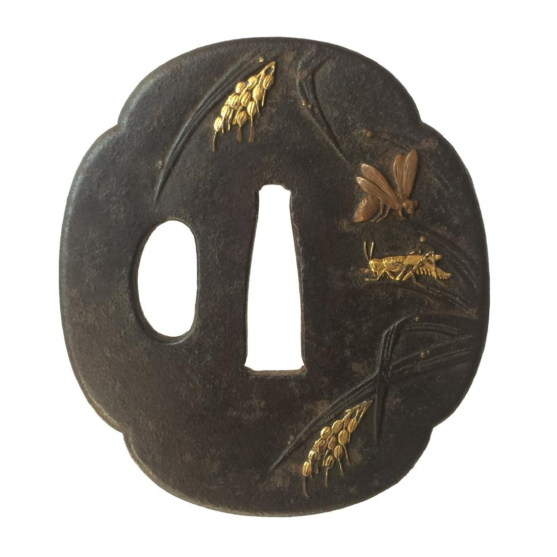 Iron tsuba inlaid with spikes and insects