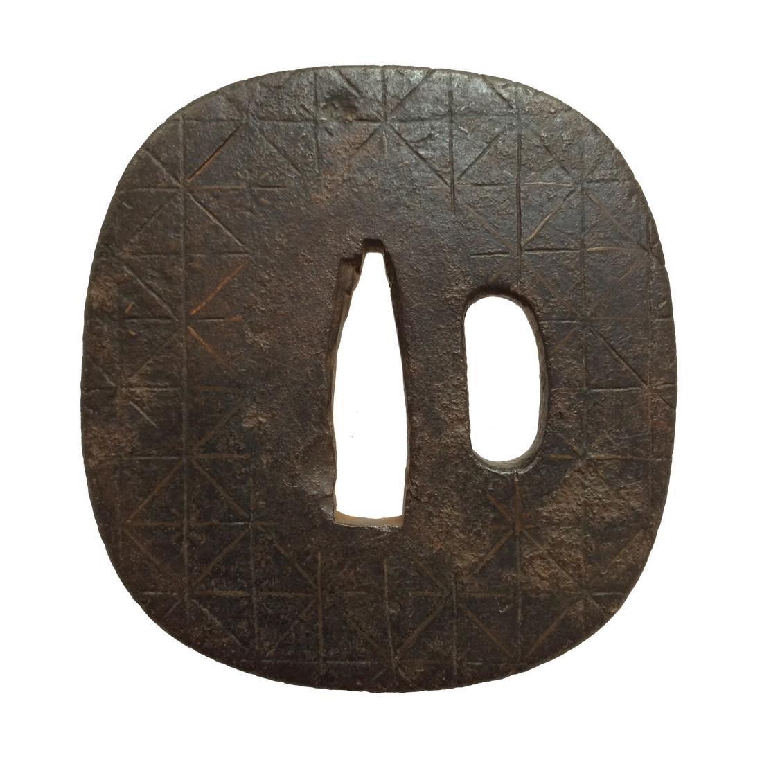 Tsuba with geometric diaper design (myriad treasures)