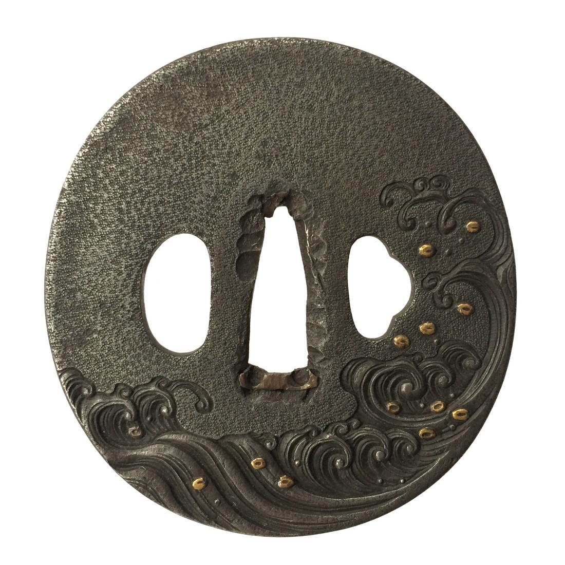 Iron tsuba with rough waves motif