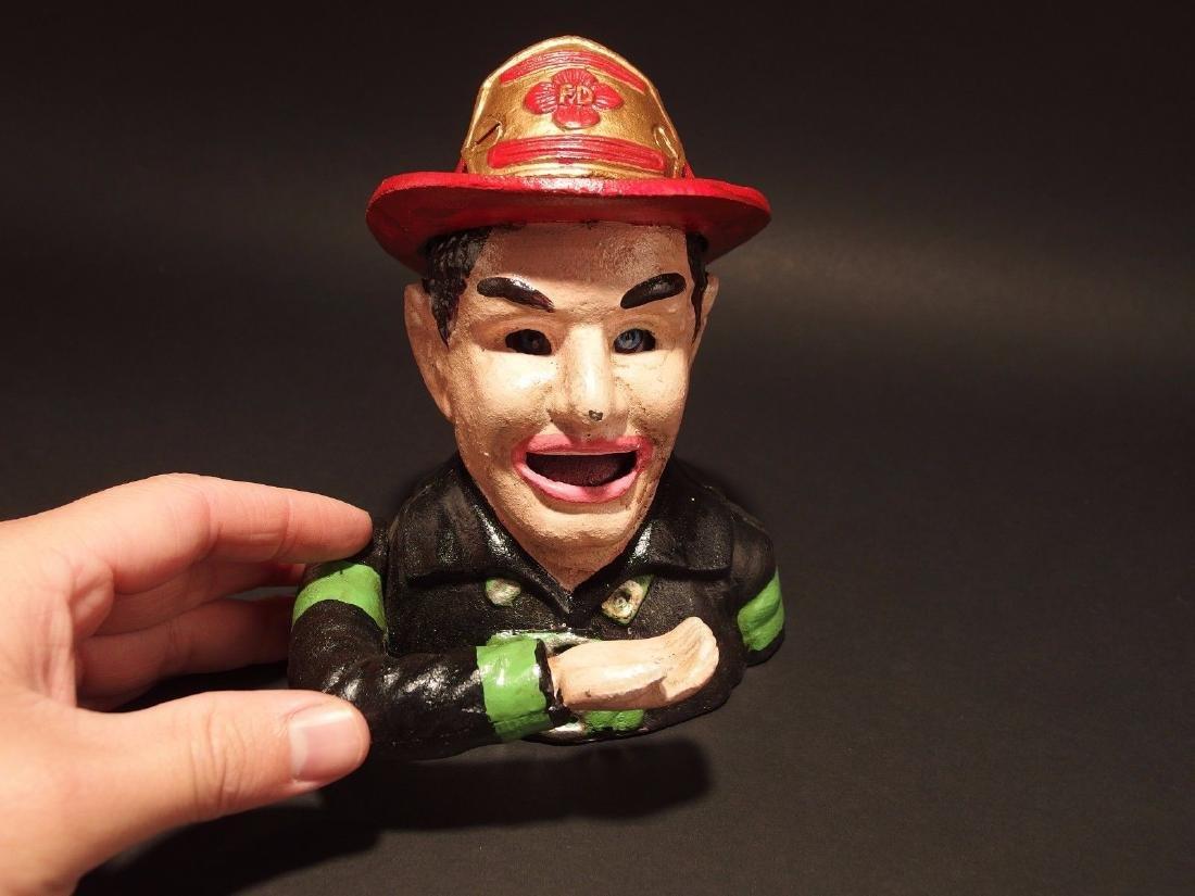 Fireman Fire Fighter Cast Iron Mechanical Coin Bank